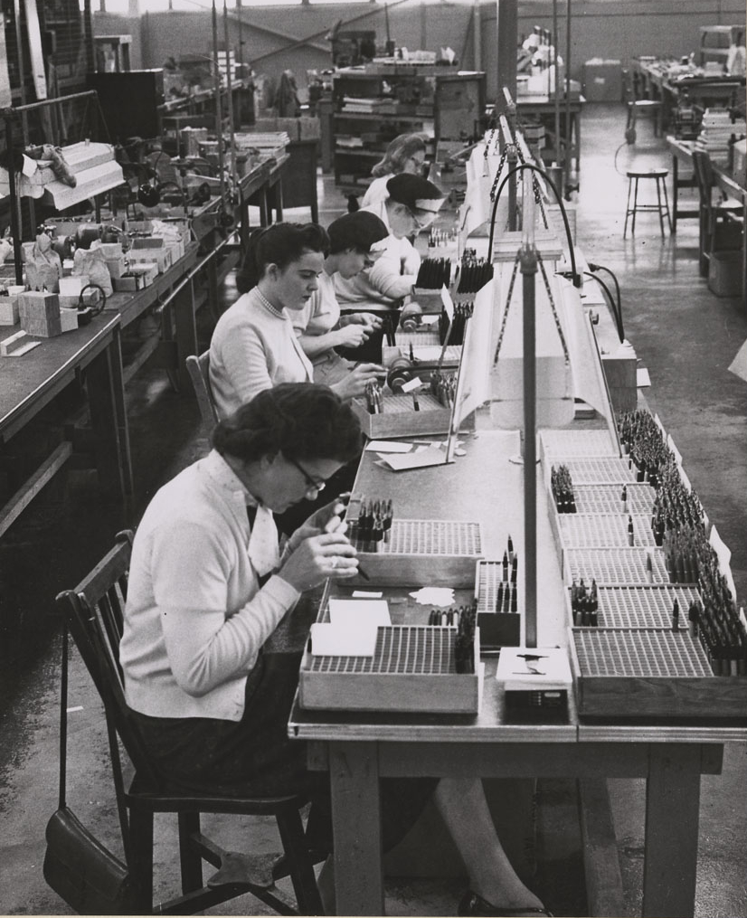 Women at work on the pen assembly line at the million dollar plant of the Sheaffer Pen Company, Ltd., established in Goderich, Ontario in 1954.