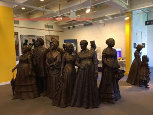 life-size statues of twenty women and men, representing the 300 who participated in the Convention including Frederick Douglass
